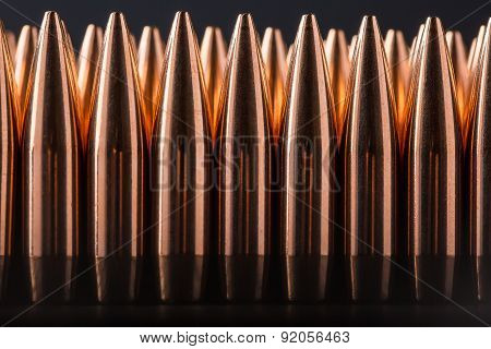 Macro shot of copper bullets that are in many row