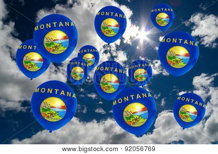 Many Balloons With Montana Flag On Sky