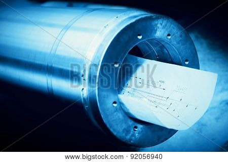 Heavy industry steel cylinder, piston with industrial plans. Blue tone.