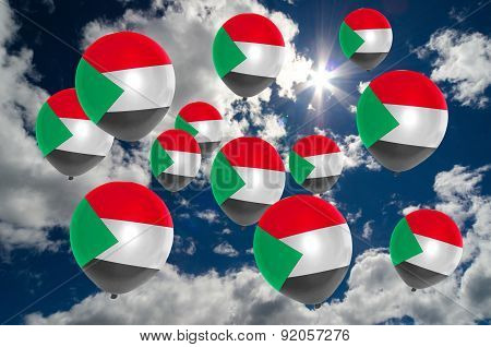 Many Balloons With Sudan Flag On Sky