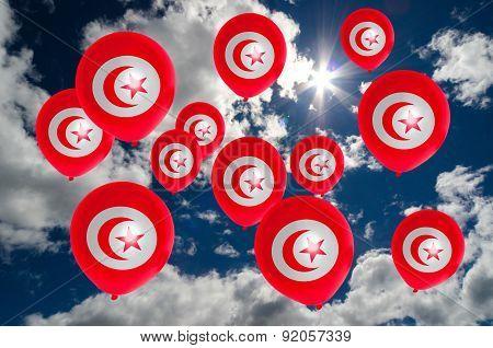 Many Balloons With Tunisia Flag On Sky