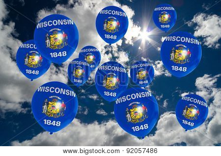 Many Balloons With Wisconsin Flag On Sky