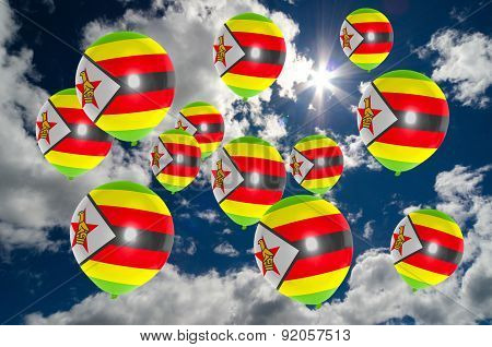 Many Balloons With Zimbabwe Flag On Sky