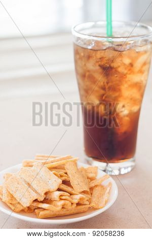 Snack On White Plate With A Glass Of Cola
