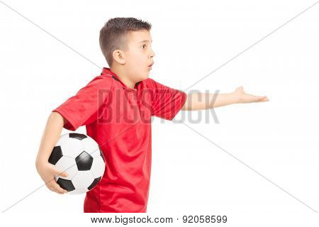 Junior football player gesturing displeasure isolated on white background