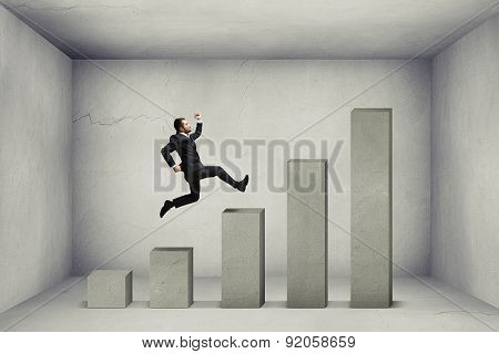 businessman running up the concrete diagram in empty grey room