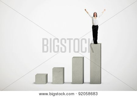 happy woman winner standing on top of concrete diagram over light grey diagram