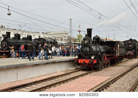 ST. PETERSBURG, RUSSIA - MAY 7, 2015: People watching the parade of steam locomotives dedicated to the WWII Victory Day. The event recreates the atmosphere of postwar years for veterans and spectators