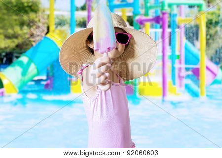 Child Showing Ice Cream At Pool