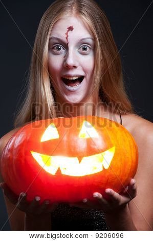 Girl Holding Orange Pumpkin