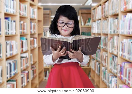 Cute Girl In The Library Aisle