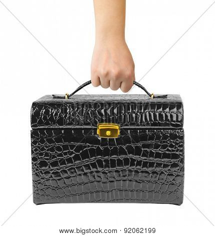 Black leather bag in hand isolated on white background