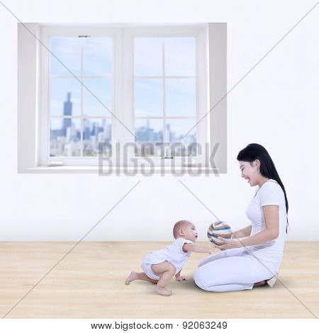Mother And Her Baby Playing Colorful Ball