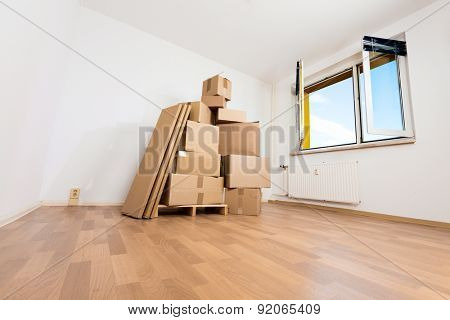 cardboard boxes in an empty apartment. moving to a new apartment Hand Truck
