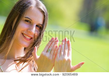 girl shows fingernails