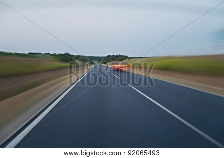 Motion blurred road viewed from a fast car