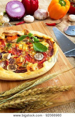 Home made seafood pizza on table