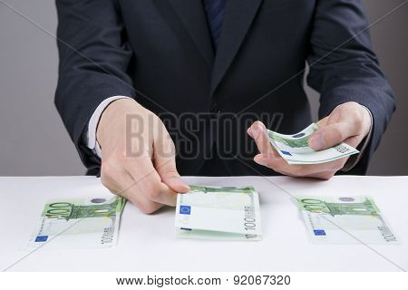 Money In The Hands Of The Men