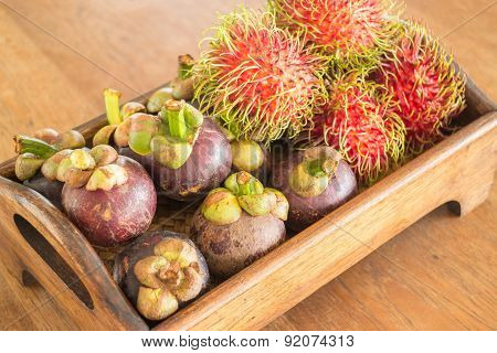 Fresh Mangosteen And Ranbutan On Wooden Tray
