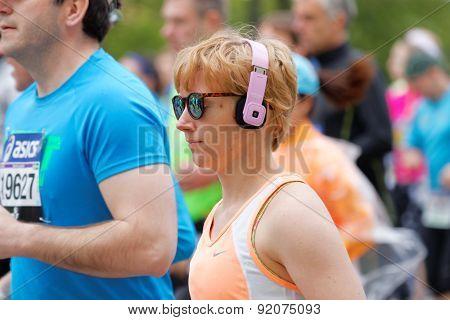 A Running Woman Wearing Headphones