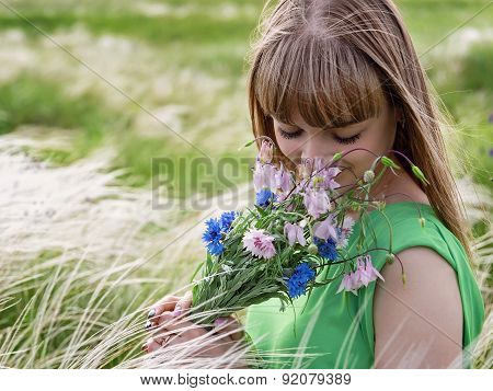 Young Sensual Girl Smelling A Bouquet Of Wildflowers