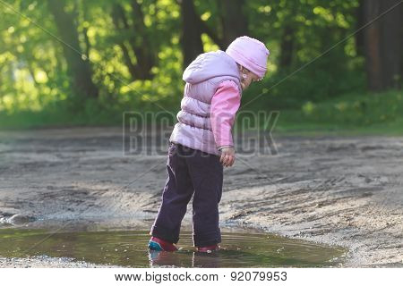 Tree Years Old Girl Exploring Summer Puddle In Red Gums