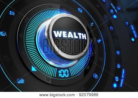 Wealth Controller On Black Control Console.