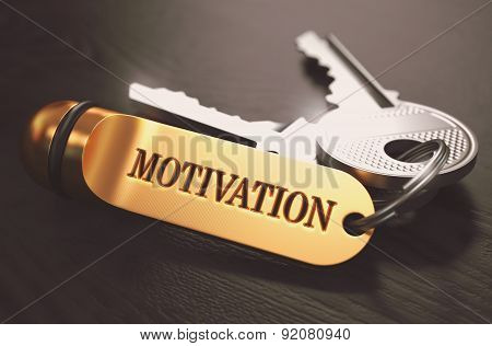 Keys To Motivation. Concept On Golden Keychain.