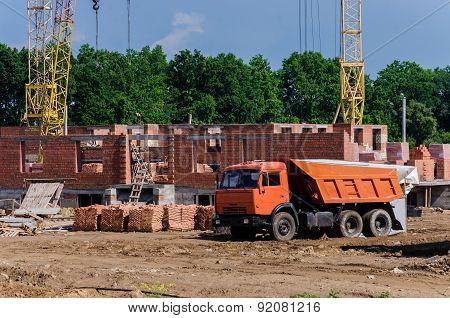 Construction Of A Small Suburban Brick House. Construction Machinery.