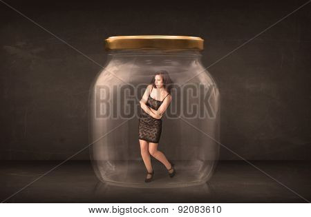 Businesswoman captured in a glass jar concept concept on background