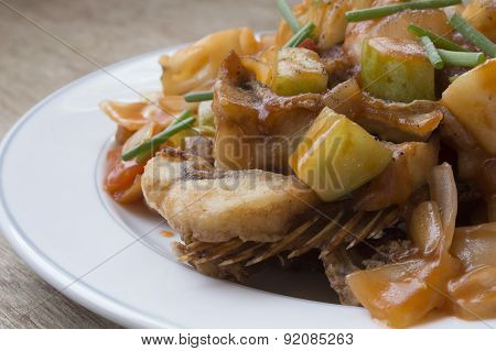 Close Up Sweet And Sour Fish Fried On White Dish