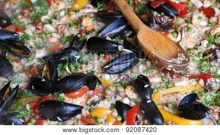 Valencian Paella Rice With Clams And Mussels And Green Peas