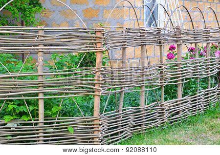 Lath Fence Around A Farmer's House In Ukraine