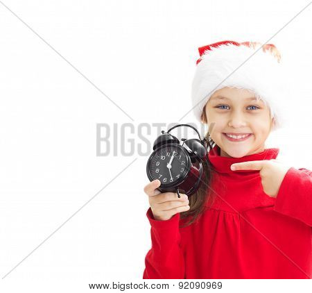 Girl In Santa Claus Hat Holding Alarm Clock