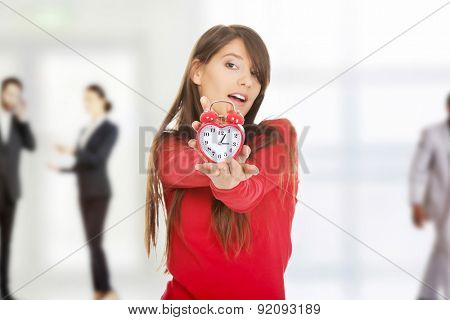 Beautiful happy student woman with alarm clock.