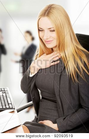 Pregnant woman in the office suffering from nausea