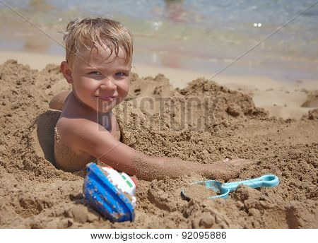 Boy play on th beach