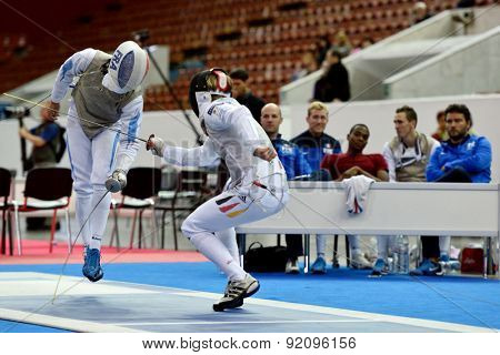 ST. PETERSBURG, RUSSIA - MAY 3, 2015: Peter Joppich of Germany vs Erwan Le Pechoux of France in team quarterfinal of 41th International fencing tournament St. Petersburg Foil, the stage of World Cup