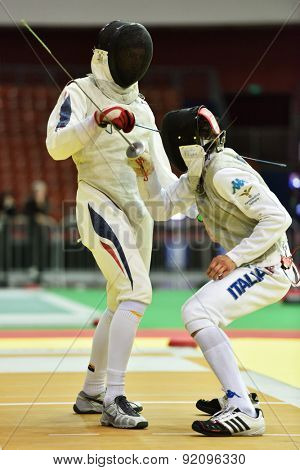 ST. PETERSBURG, RUSSIA - MAY 2, 2015: Lorenzo Nista of Italy vs Jordan Moine of France in 1/32 final of International fencing tournament St. Petersburg Foil. The tournament is the stage of World Cup