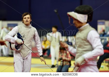 ST. PETERSBURG, RUSSIA - MAY 3, 2015: Alexey Cheremisinov of Russia in team semifinal of 41th International fencing tournament St. Petersburg Foil. The tournament is the stage of FIE World Cup
