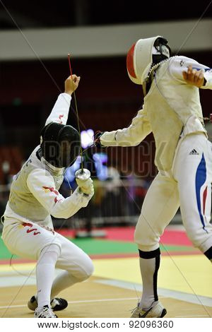 ST. PETERSBURG, RUSSIA - MAY 2, 2015: Marcel Marcilloux of France (right) vs Jianfei Ma of China in 1/32 final of 41th International fencing tournament St. Petersburg Foil, the stage of FIE World Cup