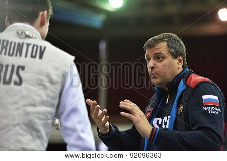 ST. PETERSBURG, RUSSIA - MAY 3, 2015: Coach Dmitry Kulayev and Pavel Borontov of Russia during 41th International fencing tournament St. Petersburg Foil. The tournament is the stage of FIE World Cup