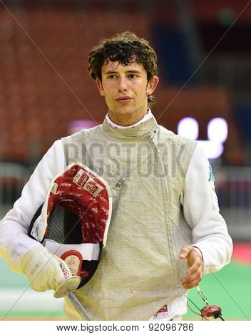 ST. PETERSBURG, RUSSIA - MAY 2, 2015: Lorenzo Nista of Italy in 1/32 final of 41th International fencing tournament St. Petersburg Foil. The tournament is the stage of FIE World Cup