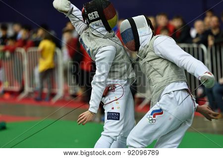 ST. PETERSBURG, RUSSIA - MAY 2, 2015: Andre Sanita of Germany vs Dmitry Rigin of Russia in 1/16 final of International fencing tournament St. Petersburg Foil. The tournament is the stage of World Cup