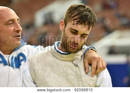 St. Petersburg, Russia - May 2, 2015: Daniele Garozzo of Italy with his coach after the 1/8 final of International fencing tournament St. Petersburg Foil. The tournament is the stage of FIE World Cup