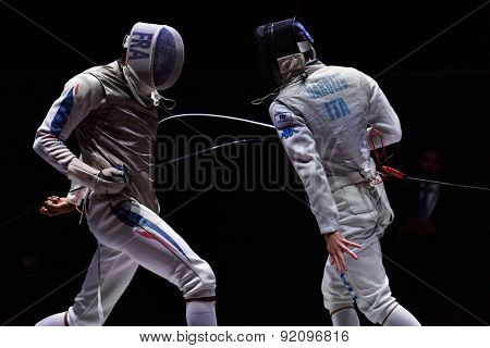 ST. PETERSBURG, RUSSIA - MAY 3, 2015: Daniele Garozzo of Italy vs Enzo Lefort of France in the team match for 3rd place of International fencing tournament St. Petersburg Foil, the stage of World Cup