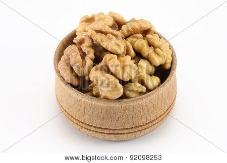 Walnut In A Round Wooden Form
