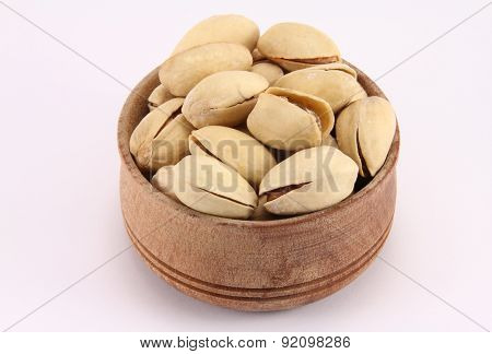 Pistachio In A Round Wooden Form