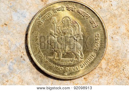 vintage coin depicting Vaishno devi image embedded in five rupee Indian coin