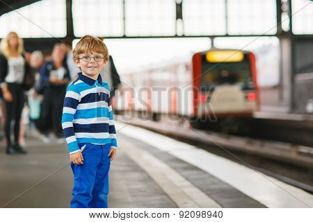 Happy Little Boy In A Subway Station.
